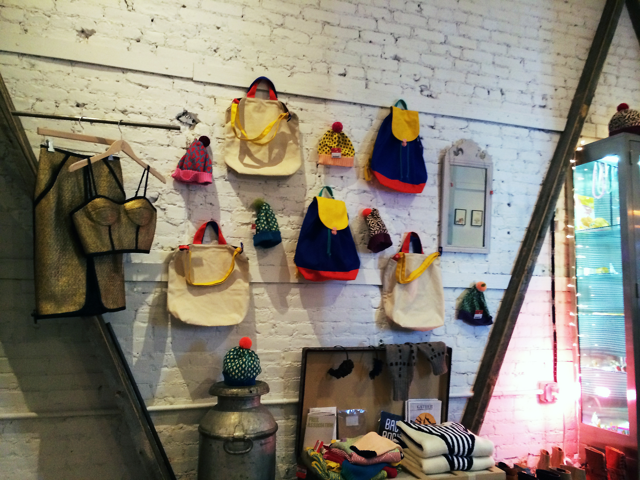 Backpack accessory wall at American Two Shot in New York. Photo by alphacityguides.