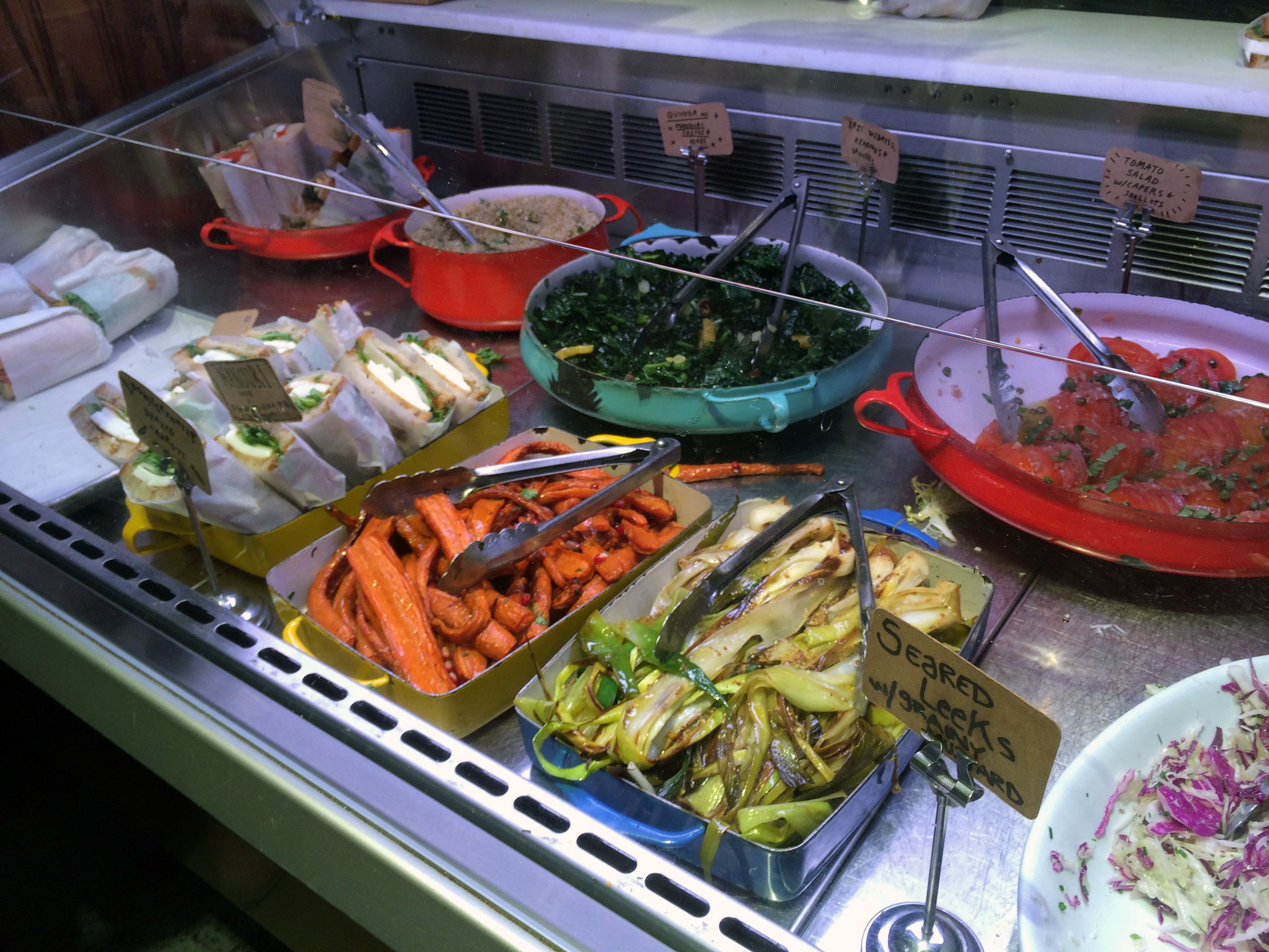 Salads and side dishes at Smile To Go in New York. Photo by alphacityguides.