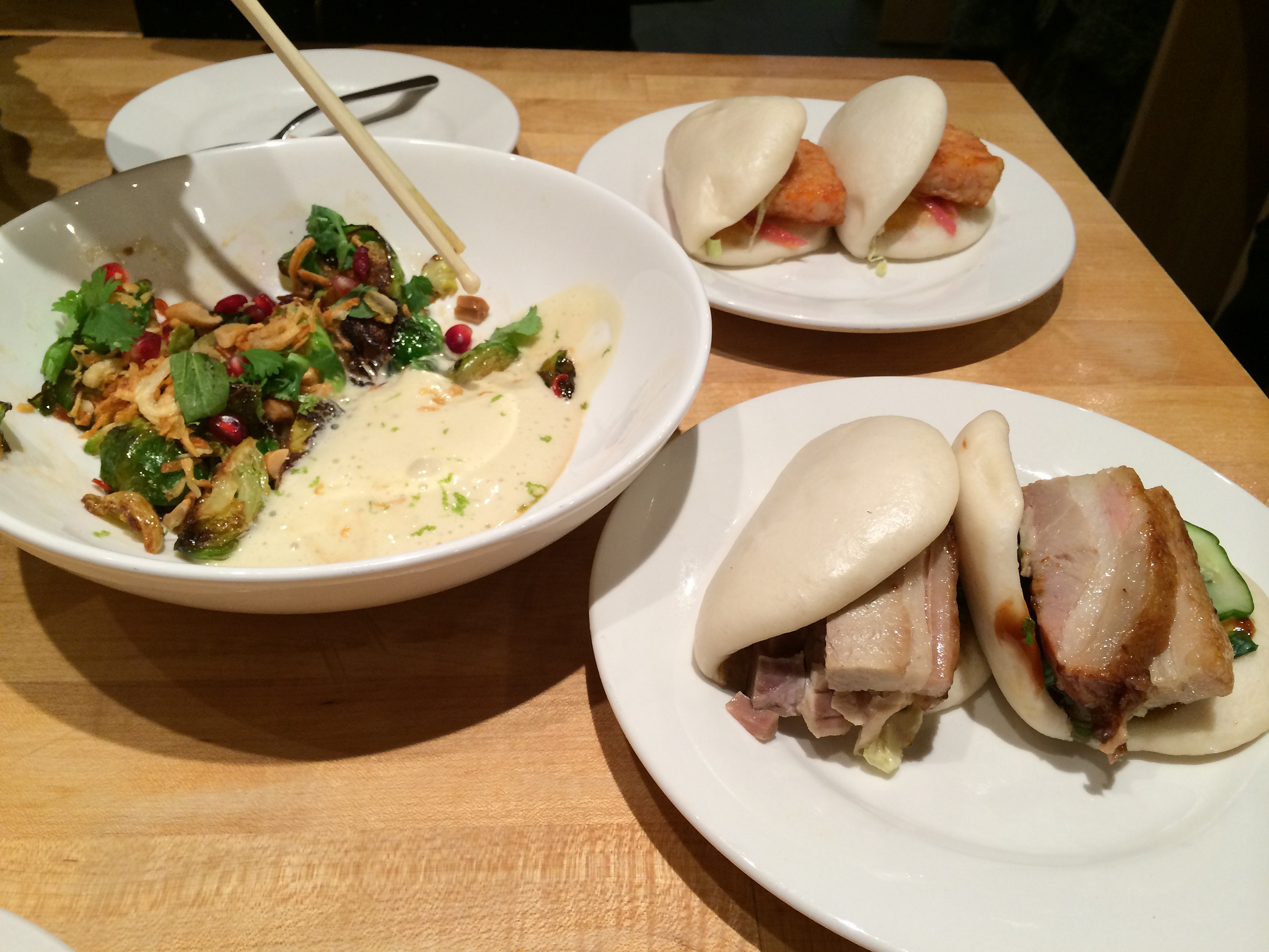 Buns and brussel sprouts at Momofuku Noodle Bar in New York. Photo by alphacityguides.