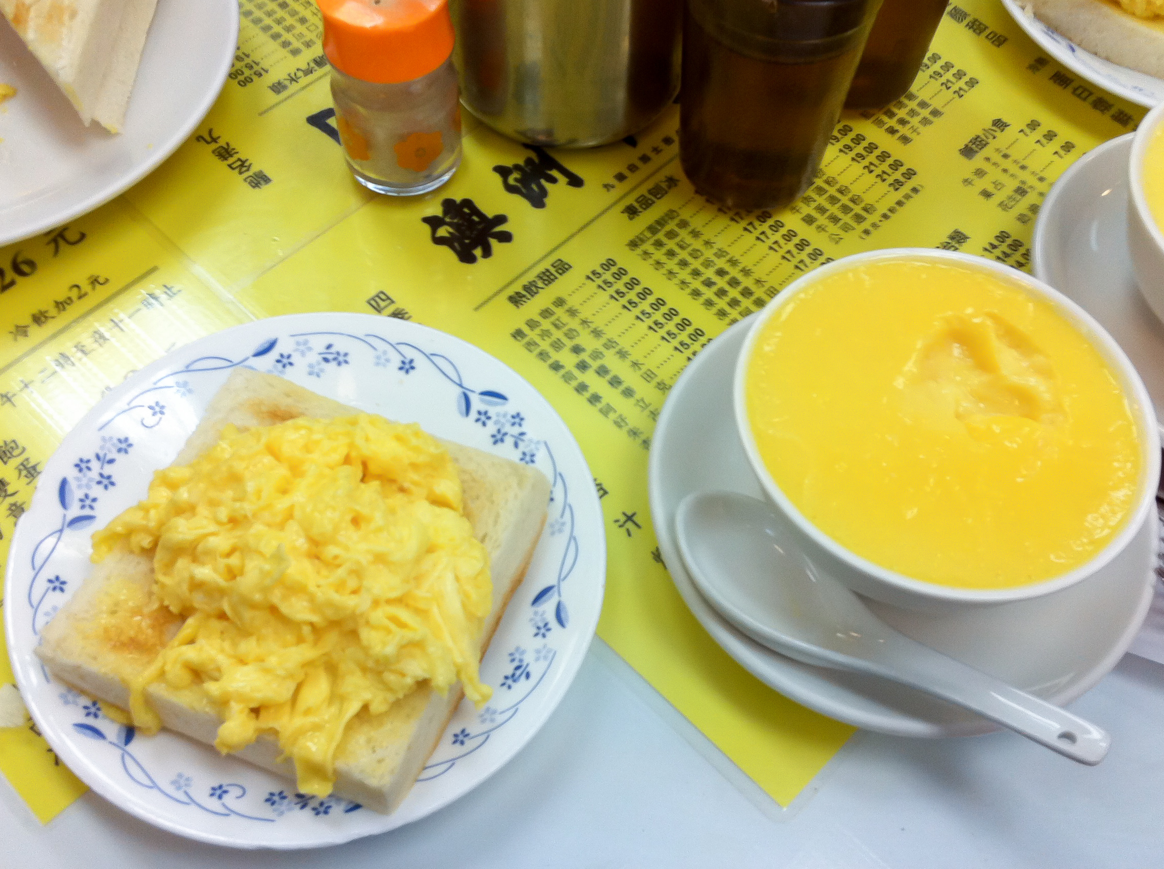 Scrambled eggs and cold custard at Australia Dairy Company in Hong Kong. Photo by alphacityguides.