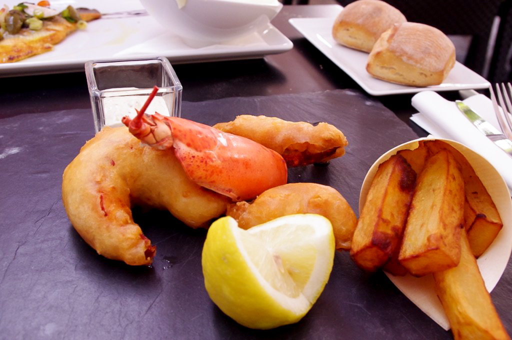 Lobster fish and chips at Publicis Drugstore Brasserie in Paris. Photo by alphacityguides.