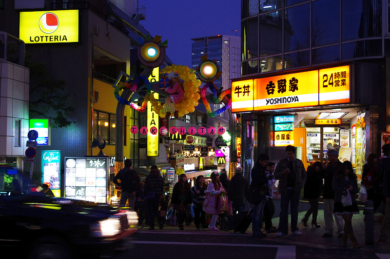 Takeshita Street at night in Tokyo. Photo by alphacityguides.