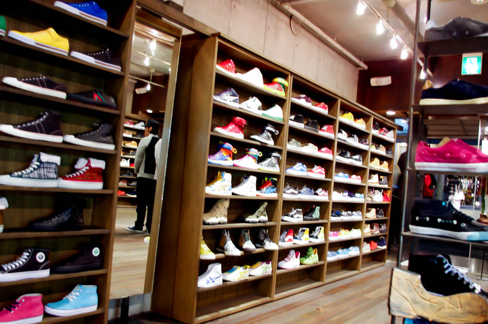 Sneaker wall at Gettry in Tokyo. Photo by alphacityguides.