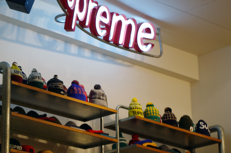 Hat display inside Supreme in Tokyo. Photo by alphacityguides.