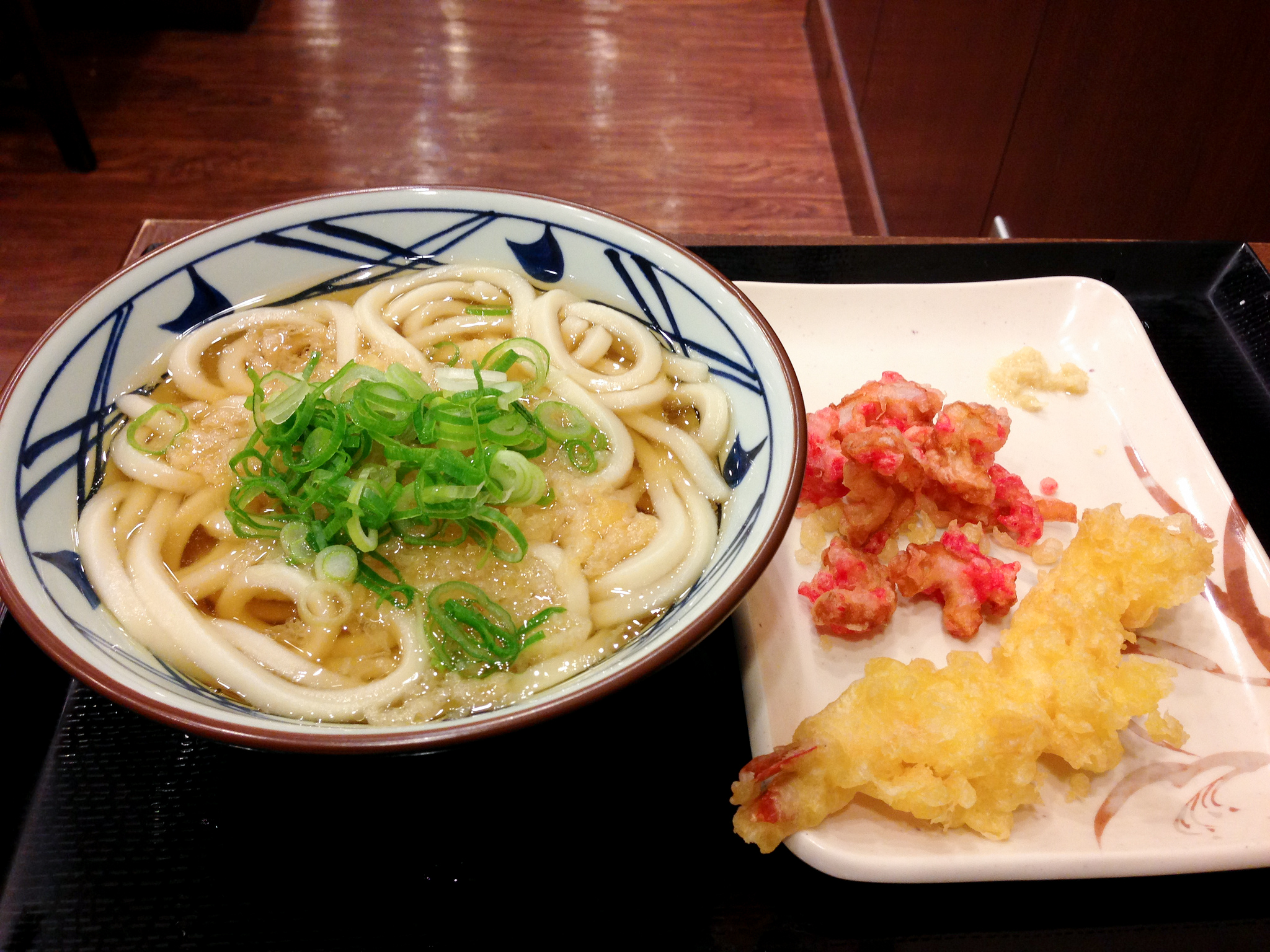 Udon bowl at Muginbo in Tokyo. Photo by alphacityguides.
