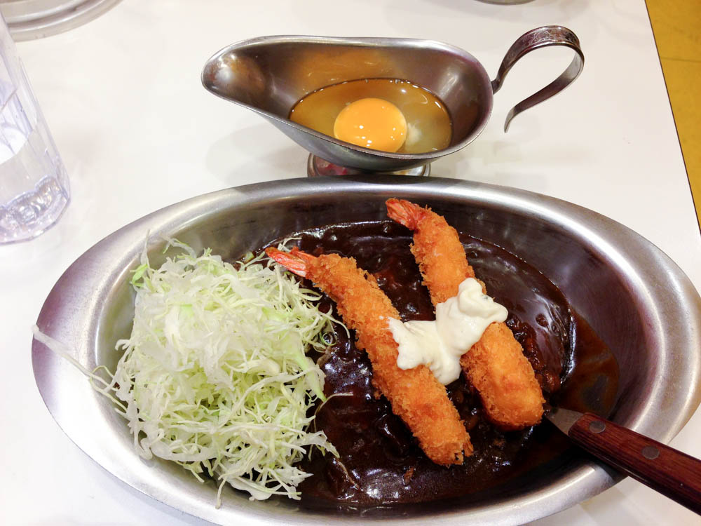 Curry and raw egg at Go Go Curry  in Tokyo. Photo by alphacityguides.