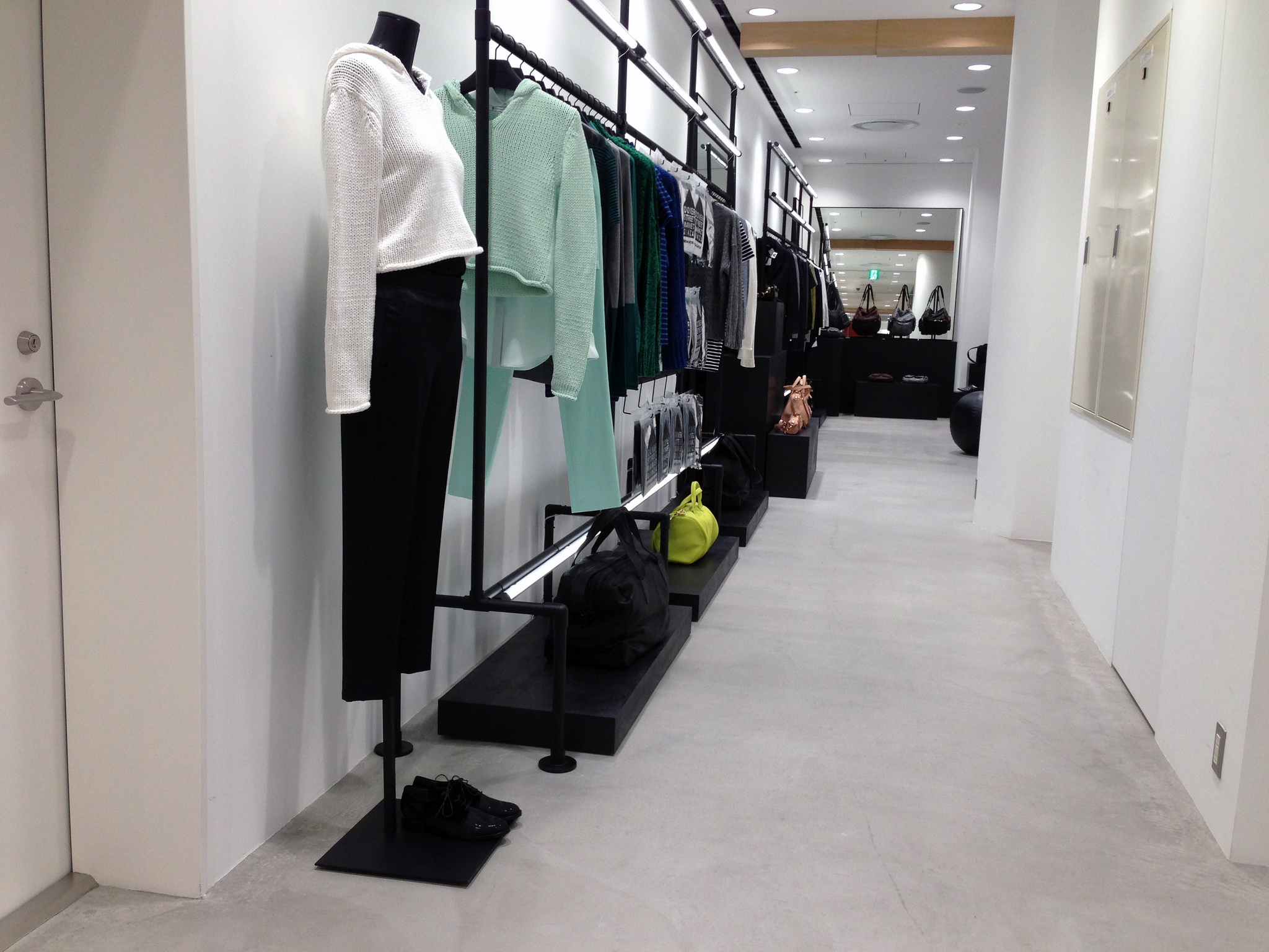 Fashion display and merchandising inside Dover Street Market in Tokyo. Photo by alphacityguides.