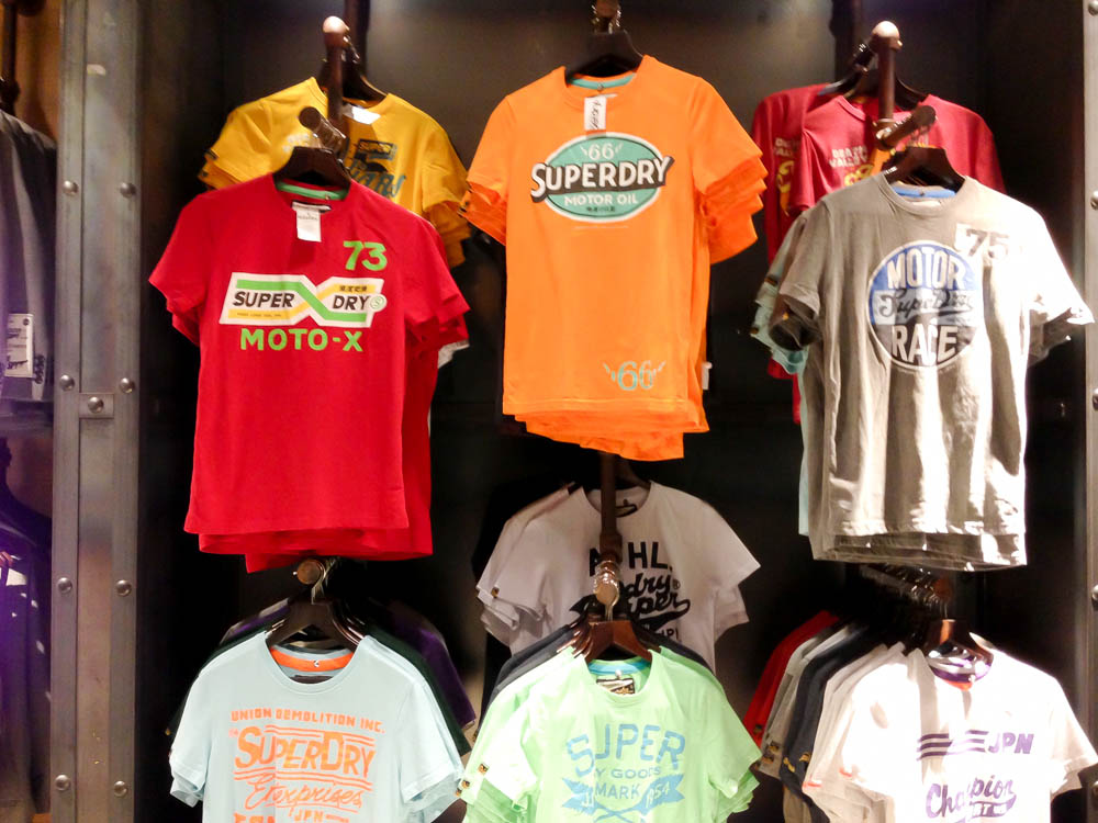 T-shirt wall at Superdry in London. Photo by alphacityguides.