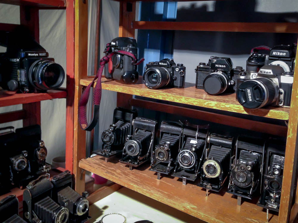 Vintage camera display at the Portobello Market in London. Photo by alphacityguides.