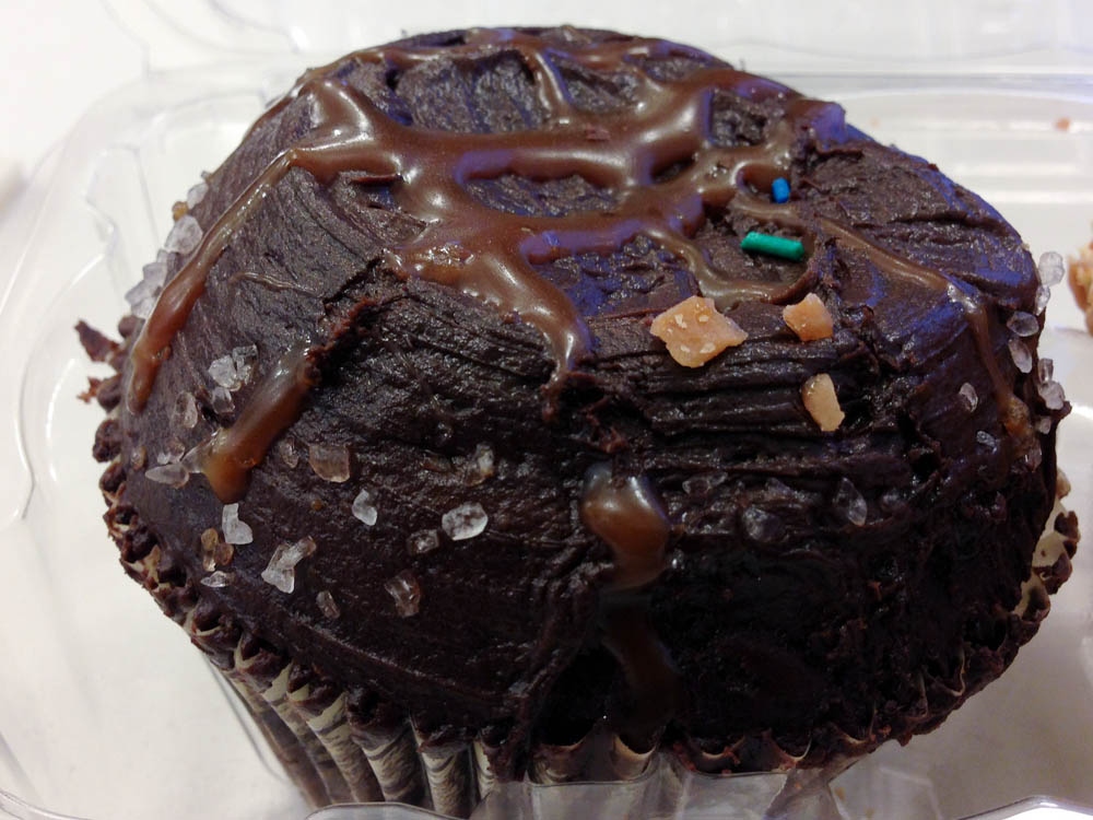 Salted caramel chocolate cupcake at Crumbs Bake Shop in New York. Photo by alphacityguides.