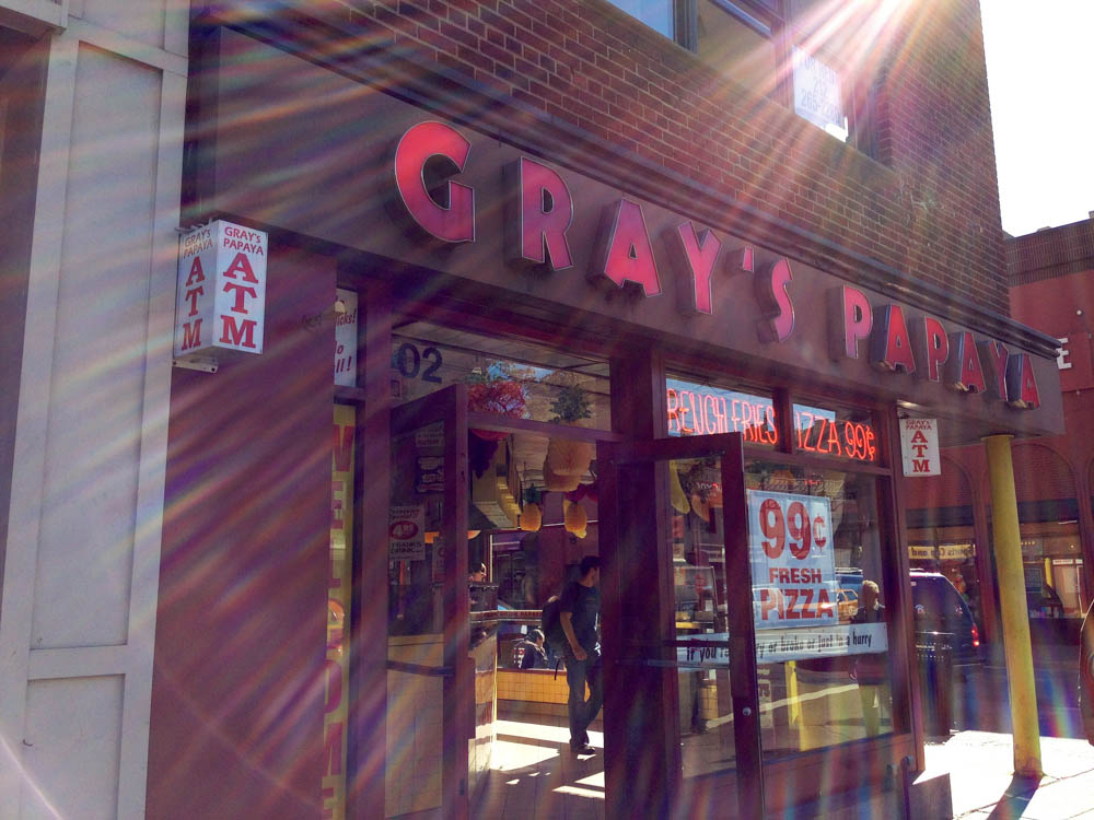 Store front at Gray's Papaya in New York. Photo by alphacityguides.