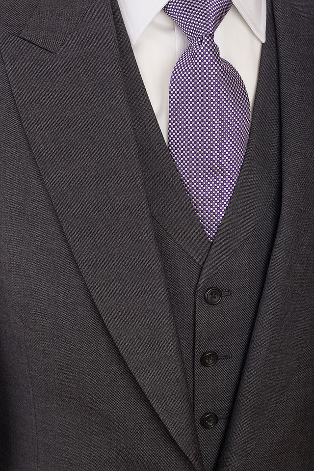 Bespoke three piece suit.