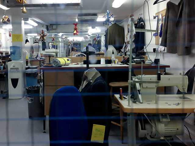 Savile Row Tailor at work in his workshop. Photo by alphacityguides.