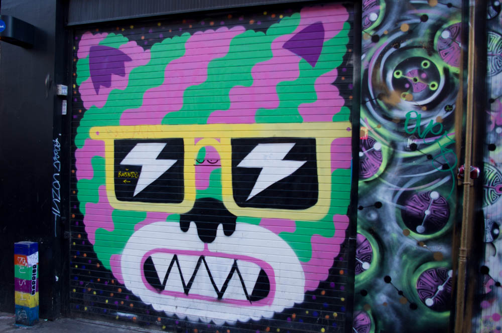 Graffiti at Brick Lane in London. Photo by alphacityguides.