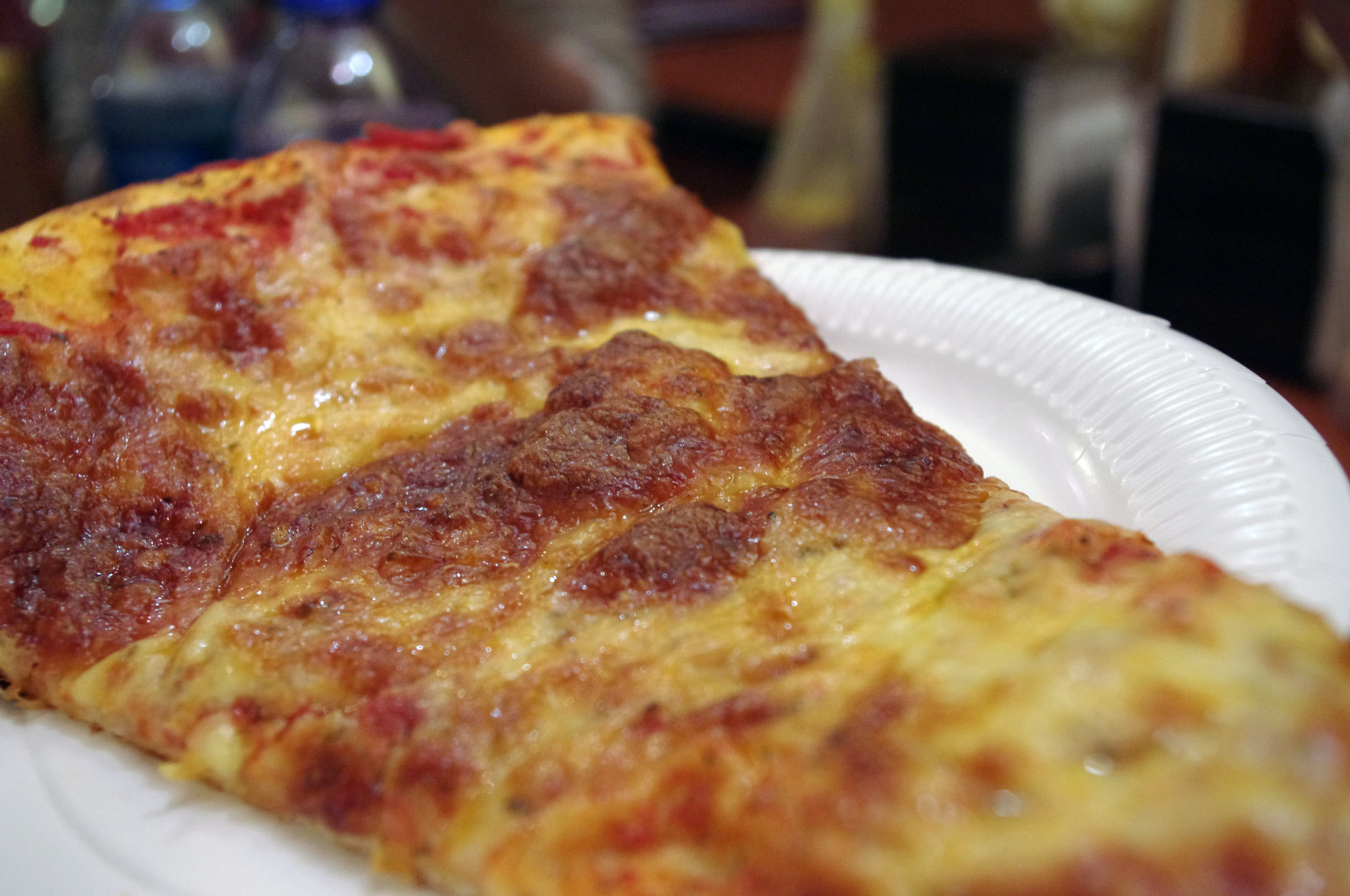 Pizza at Paisano's Pizzeria & Sub Shop in Hong Kong. Photo by alphacityguides.
