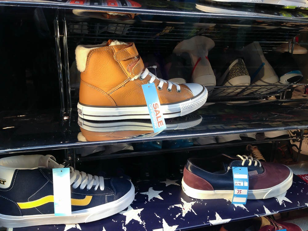 3387b77cc38d Sneaker wall at Offspring in London. Photo by alphacityguides. Nike Dunk  Sky High Liberty print wedge heel ...