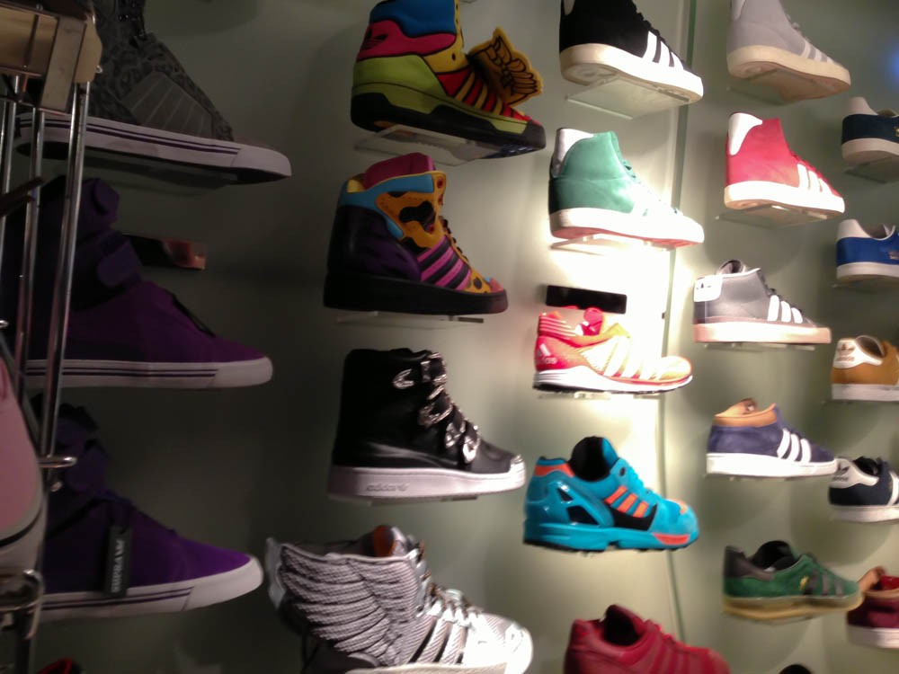 c1e77c58f1a2 Nike Dunk Sky High Liberty print wedge heel sneaker at Offspring in London.  Photo by  Sneaker wall at Offspring in London. Photo by alphacityguides.