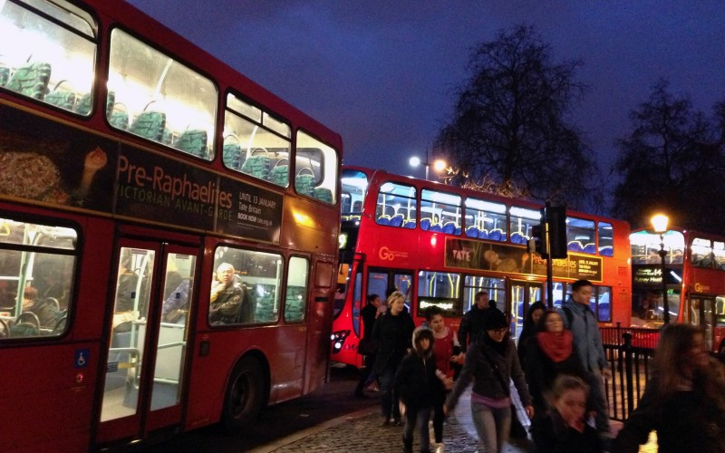 Big red double decker bus in London. Photo by alphacityguides.