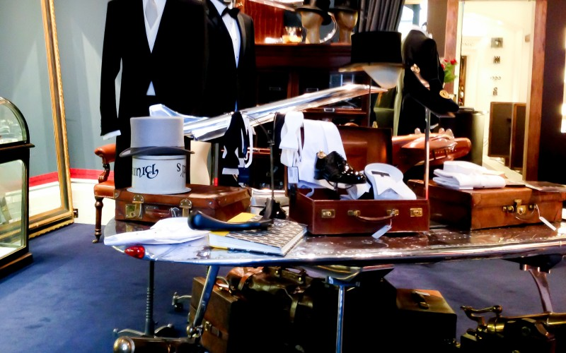 Suiting and accessories inside of Gieves & Hawkes on Savile Row in London. Photo by alphacityguides.
