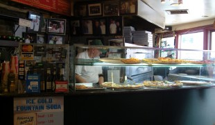 Pizza counter at Bleecker Street Pizza.