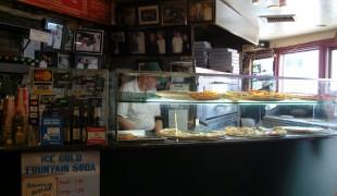 Pizza counter at Bleecker Street Pizza.