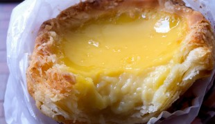 Egg tart at Honolulu Coffee Shop in Hong Kong. Photo by alphacityguides.
