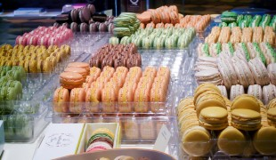 Macaron display at Pierre Hermé in Paris. Photo by alphacityguides.