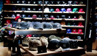 Hat wall inside New Era in Tokyo. Photo by alphacityguides.