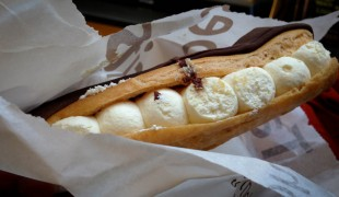 Chocolate Eclair with chantilly cream at Euporium Bakery in Covent Garden, London. Photo by alphacityguides.