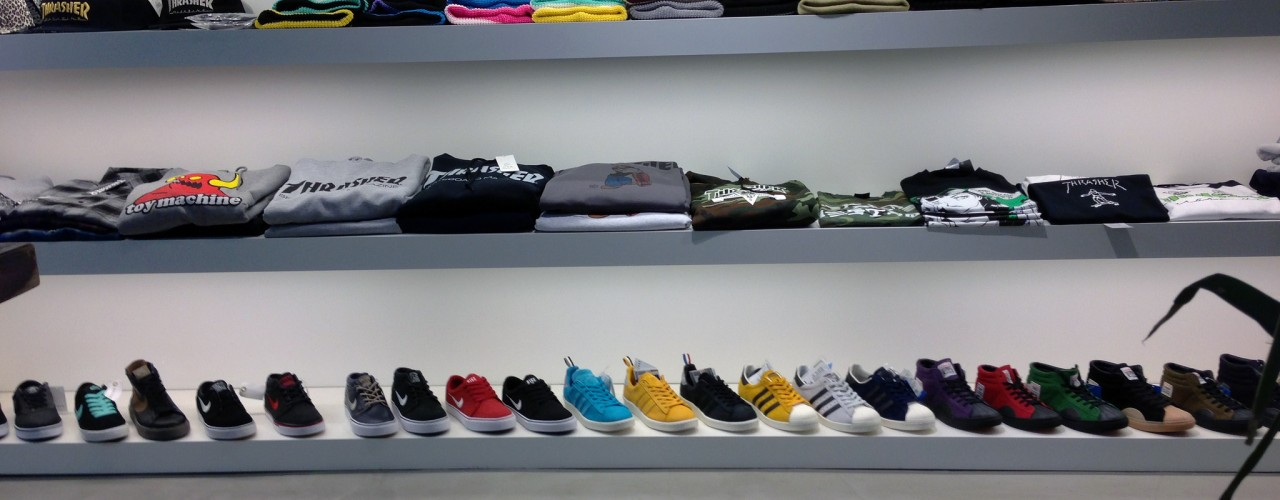 Sneaker and t-shirt wall at atmos in Tokyo. Photo by alphacityguides.
