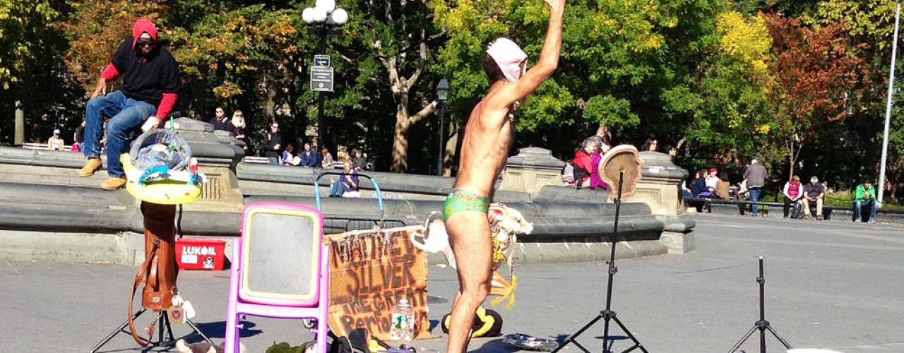 Eclectic street performer in Washington Square Park in New York. Photo by alphacityguides.