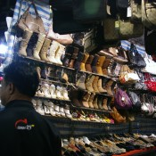 Cheap shoes at the Temple Street Market in Hong Kong. Photo by alphacityguides.