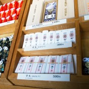 Prayer trinkets and good luck charms at Meiji Shrine in Tokyo. Photo by alphacityguides.