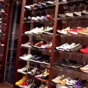 Sneaker wall inside Kicks Lab in Tokyo. Photo by alphacityguides.