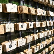 Ema prayer tables at Meiji Shrine in Tokyo. Photo by alphacityguides.