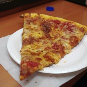 Slice at Paisano's Pizzeria & Sub Shop in Hong Kong. Photo by alphacityguides.
