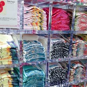 T-shirt wall inside Uniqlo in Tokyo. Photo by alphacityguides.