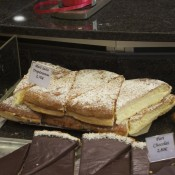 Tarte Tropezienne slices on display at La Fougasse in Paris