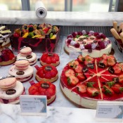 Cake and pastry diplay at Harrods in London. Photo by alphacityguides.
