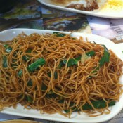 Fried noodles at Tim Ho Wan in Hong Kong. Photo by alphacityguides.
