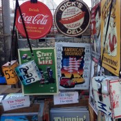 Vintage signs at Hell's Kitchen Market in New York. Photo by alphacityguides.