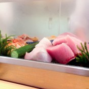 Sushi display case at Daiwa Sushi in Tokyo. Photo by alphacityguides.