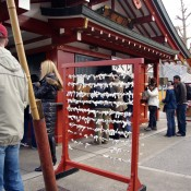 Omikuji rack to tie fortunes at Sensoji Temple in Tokyo. Photo by alphacityguides.