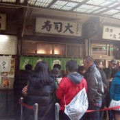 Store front at Sushi Dai in Tokyo. Photo by alphacityguides.