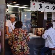 Man at the Tsukiji fish market in Tokyo. Photo by alphacityguides.