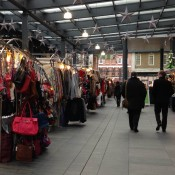 Collection of stalls at Old Spitalfields Market in London. Photo by alphacityguides.