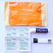 Cleansing wipes, alcohol swabs, lip balm and sugar for your face scrub.