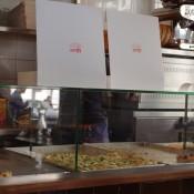 Where the magic happens—the pizza counter at Al Taglio in Paris. Photo by alphacityguides.