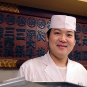 Young sushi chef at Sushi Dai in Tokyo. Photo by alphacityguides.