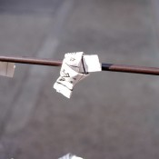 Tied Omikuji fortunes at Sensoji Temple in Tokyo. Photo by alphacityguides.